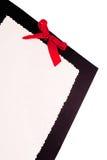 Бумага с красным смычком Стоковые Изображения