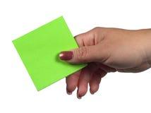 бумага удерживания руки Стоковое Фото