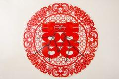 Бумаг-отрезок и 2 абстрактных люд и обручальное кольцо Стоковая Фотография
