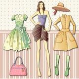 Бумажная кукла с одеждами Стоковые Изображения RF