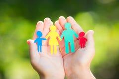 Бумажная семья в руках Стоковая Фотография RF