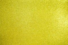 Бумажная текстура золота яркого блеска для предпосылки Стоковое Изображение