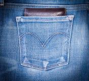 Бумажник и джинсы Стоковое Изображение