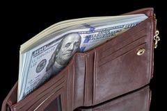 Бумажник с пакетом долларов на черноте Стоковые Фотографии RF