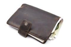 Бумажник Brown с валютой Стоковая Фотография