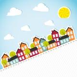 Бумажное знамя с маленьким городом Стоковое Изображение