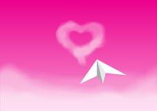Бумажное плоское летание в розовом небе Стоковая Фотография RF