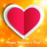 Бумажное сердце изолированное на сияющей оранжевой предпосылке. Стоковые Фото