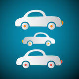 Бумажные автомобили на голубой предпосылке Стоковое фото RF