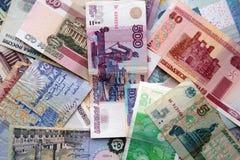 Бумажные банкноты различных стран Стоковые Фото
