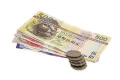 Бумажные деньги и монетки Гонконга стоковые изображения