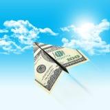 Бумажный самолет сделанный 100 долларовых банкнот Стоковая Фотография