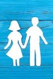 Бумажный силуэт человека и женщины держа руки Стоковая Фотография RF