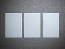 3 бумажных листа на сером поле Стоковая Фотография RF