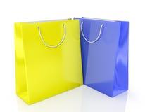 2 бумажных хозяйственной сумки желтый цвет и синь Стоковые Фото