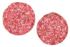 2 бургера сырого мяса для гамбургеров на белизне Стоковая Фотография RF