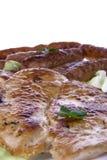 Бургер и сосиски цыпленка Стоковая Фотография