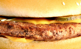 Бургер части макроса Стоковые Фотографии RF