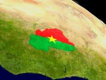 Буркина Фасо с флагом на земле Стоковые Изображения