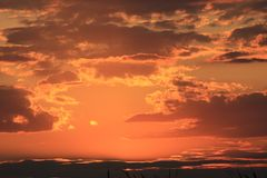 Бурный заход солнца природы облака Стоковая Фотография
