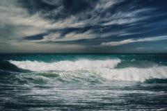 Бурный океан с ненастными облаками Стоковое Фото