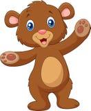 Бурого медведя младенца шаржа рука счастливого развевая Стоковая Фотография RF