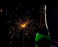 Бутылка и sparklers Шампань Стоковая Фотография RF