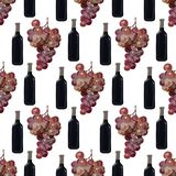 Бутылка красного вина с виноградинами, безшовной картины Стоковые Фото