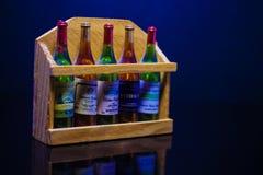 Бутылки вина на голубой предпосылке стоковые изображения rf