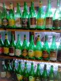 Бутылки в магазине Стоковая Фотография