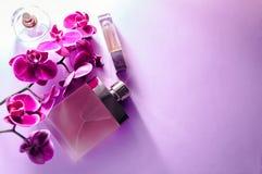 Бутылки дух с орхидеей Стоковые Фото