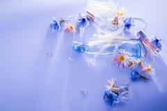 Бутылки дух с цветками Стоковое Изображение
