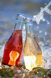 2 бутылки коктеиля на пляже Стоковые Изображения