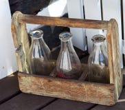 Бутылки молока на шаге Стоковые Изображения RF