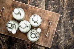Бутылки с парным молоком Стоковое Фото