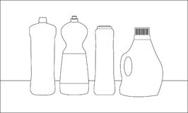 Бутылки чистки на таблице Стоковые Изображения