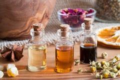 Бутылки эфирного масла с анисовкой звезды, стоцветом и frankinc Стоковая Фотография