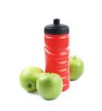 Бутылка и яблоки питьевой воды Стоковое фото RF