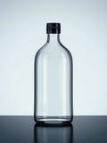 Бутылка на поле Стоковые Изображения