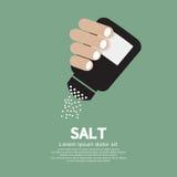 Бутылка соли в руке Стоковые Изображения