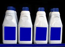Бутылки автотракторного масла масло автомобиля Стоковая Фотография