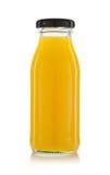 Бутылки апельсинового сока изолированные на белизне Стоковые Изображения RF
