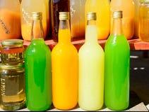 Бутылки апельсинового сока и лимона Стоковое фото RF