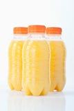 Бутылки апельсинового сока на белой предпосылке Стоковое Изображение RF
