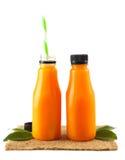 2 бутылки апельсинового сока Стоковые Фотографии RF