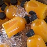 Бутылки апельсинового сока Стоковые Фотографии RF