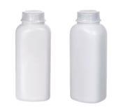 2 бутылки белых  plastiÑ малых Стоковая Фотография RF