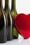Бутылки вина и красного сердца Стоковое Изображение RF