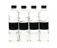 Бутылки воды соды пластичные с пустым ярлыком Изолировано на белизне Стоковые Фото