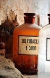 Бутылки в средневековой фармации Стоковая Фотография